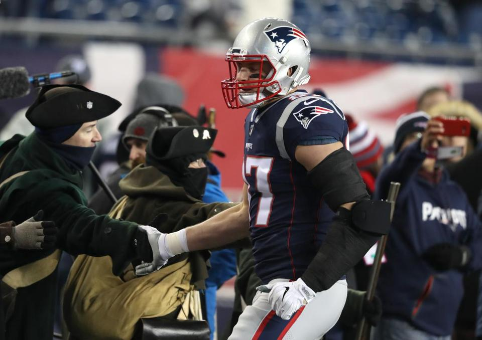 Rob Gronkowski greets the End Zone Militia before the game.