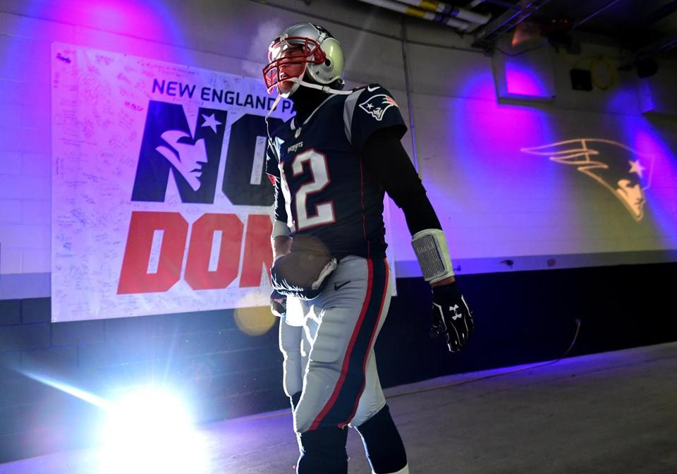 Brady walks through the tunnel before taking the field.