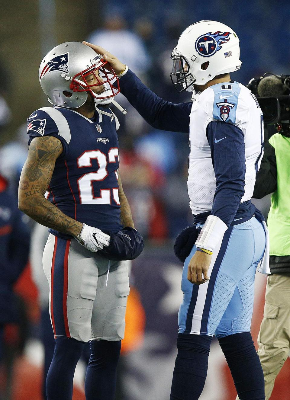 Safety Patrick Chung and quarterback Marcus Mariota catch up during warmups.