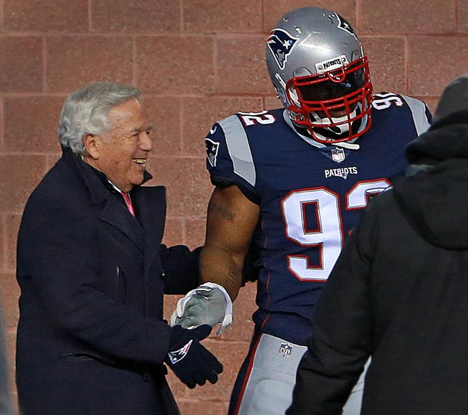 Team owner Robert Kraft and linebacker James Harrison shake hands before the game.