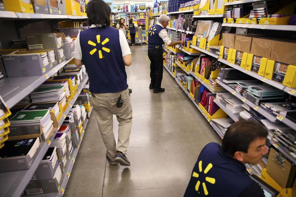 Employees restocked shelves at a Wal-Mart in Burbank, Calif., in August.