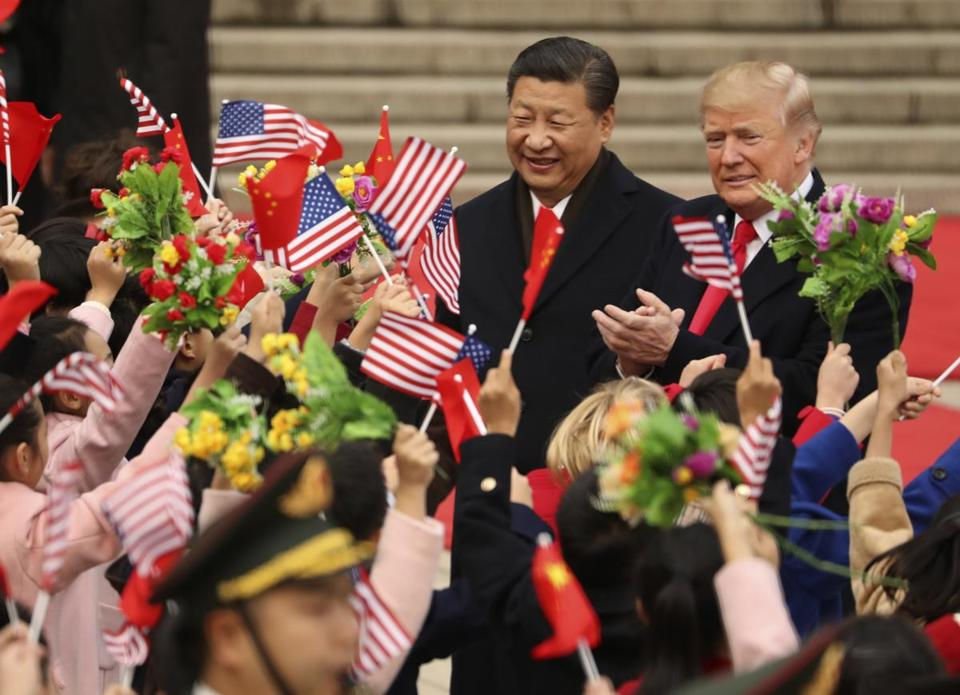 "FILE - In this Nov. 9, 2017, file photo, President Donald Trump and Chinese President Xi Jinping participate in a welcome ceremony at the Great Hall of the People in Beijing, China. Trump couldn't seem to stop talking about the red carpets, military parades and fancy dinners that were lavished upon him during ""state visits"" on his recent tour of Asia. ""Magnificent,"" he declared at one point on the trip. But Trump has yet to reciprocate in kind. In fact, he is the first president in decades to close his first year in office without welcoming a counterpart on a visit to the U.S. with similar trappings. (AP Photo/Andrew Harnik, File)"