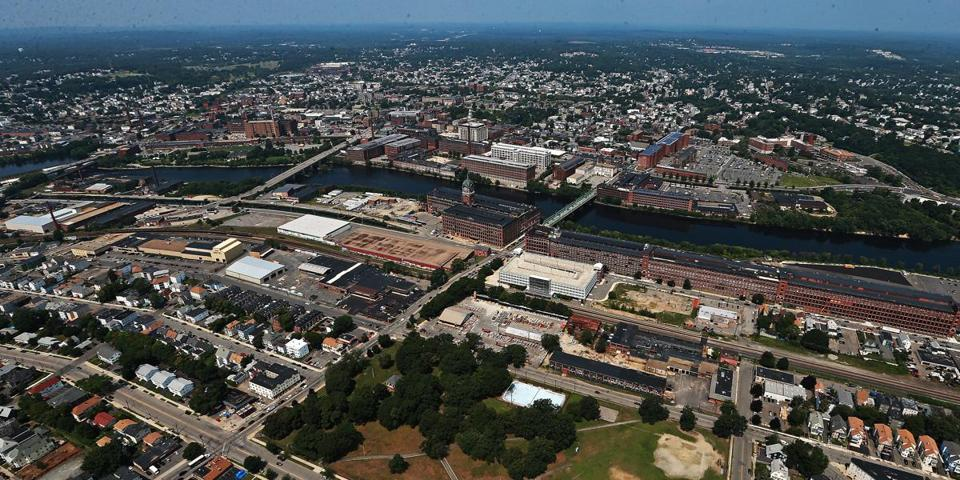 08/05/14: Lawrence, MA: NOTE: I SHOT THIS ON THE WAY TO DO AN AERIAL VIEW OF A MARKET BASKET RALLY IN AUGUST.........An aerial view of the city of Lawrence with mills along the Merrimack River in the middle. The view is looking northward, with South Lawrence seen at the bottom. (Jim Davis/Globe Staff) section: business topic: 011815LocationPics
