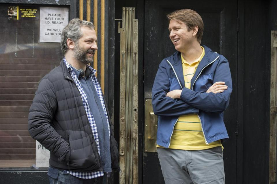 acing page: Judd Apatow and Holmes on the set of Crashing during season 1.