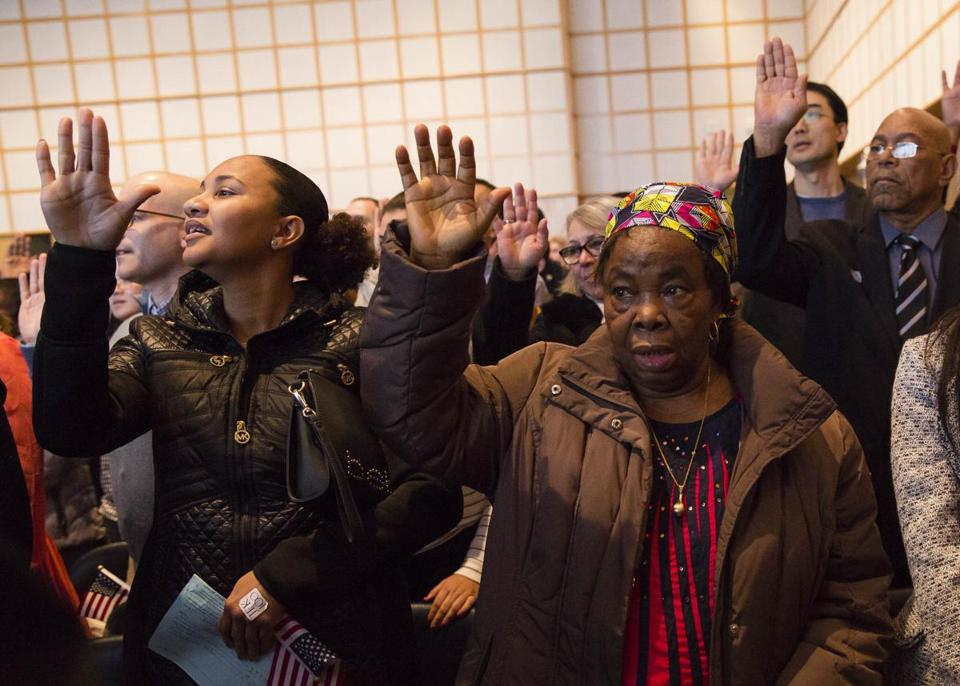 Anna Nwaibari Okoro (right), from Nigeria, joined others for the citizenship oath Wednesday at the John F. Kennedy Presidential Library and Museum in Boston.