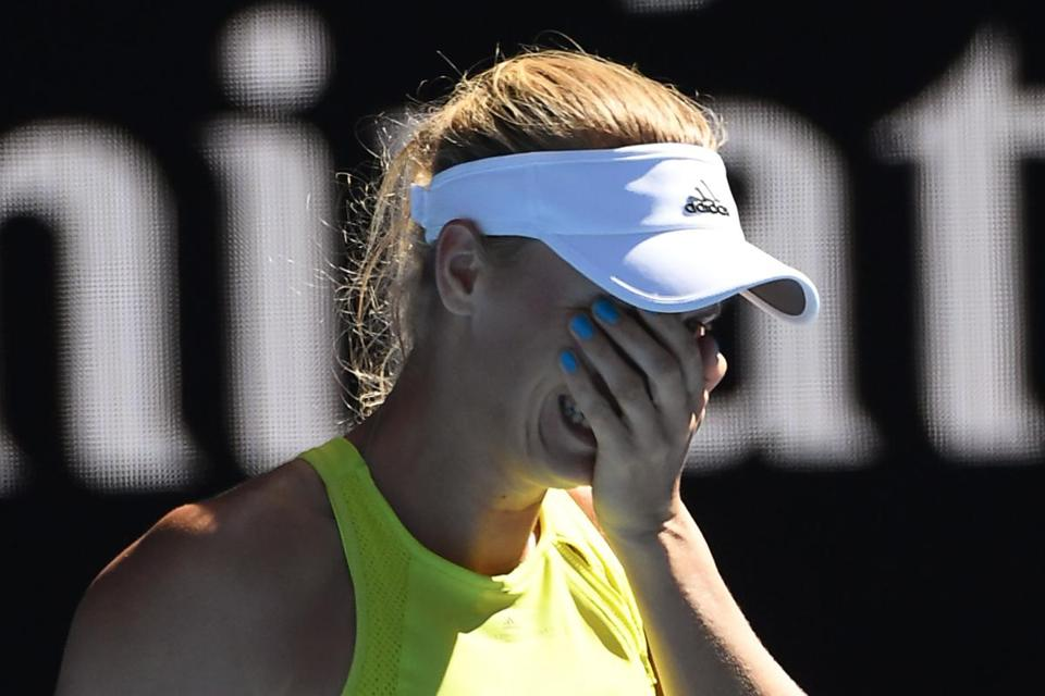Denmark's Caroline Wozniacki reacts after beating Croatia's Jana Fett in their women's singles second round match on day three of the Australian Open tennis tournament in Melbourne on January 17, 2018. / AFP PHOTO / WILLIAM WEST / -- IMAGE RESTRICTED TO EDITORIAL USE - STRICTLY NO COMMERCIAL USE --WILLIAM WEST/AFP/Getty Images
