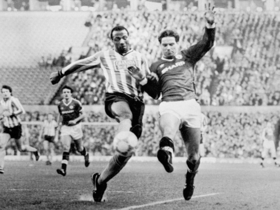 Mr. Regis (left) was an imposing striker for West Bromwich and Coventry and other clubs.