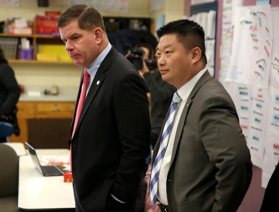 01/18/2018 Boston Ma - Boston Mayor Marty Walsh (cq) left and BPS Superintendent Tommy Chang (cq) right was at the Mario UMana Academy in East Boston for the announcement of a Federal grant to expand the BoStem program. .Jonathan Wiggs /Globe Staff Reporter:Topic.
