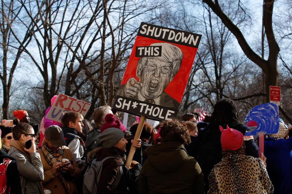 A woman holds a sign during the Second Annual Womens March Chicago on January 20, 2018. / AFP PHOTO / Kena BetancurKENA BETANCUR/AFP/Getty Images