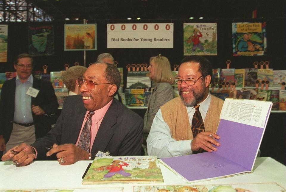 Professor Lester (left) collaborated with African-American illustrator Jerry Pinkney (right) on children's books.