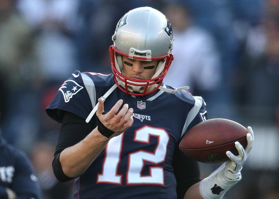Black tape is seen on Brady's right hand.
