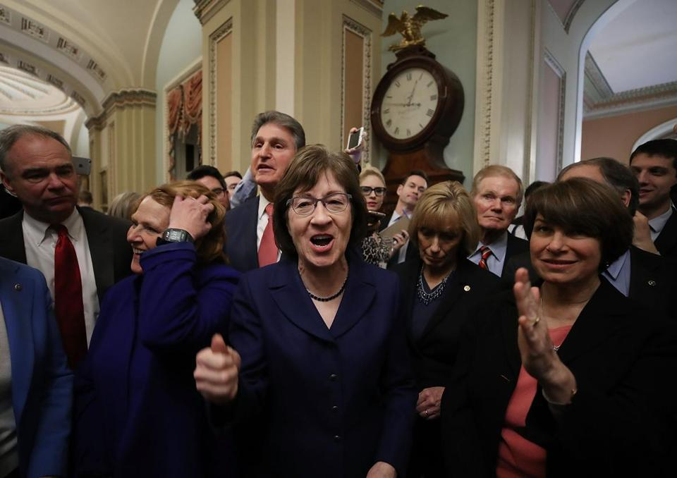 US Senator Susan Collins (center), Republican of Maine, celebrated Monday after the Senate voted and passed a continuing resolution to reopen the federal government.
