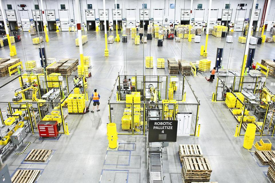 Employees worked alongside robots in an Amazon warehouse in Florence, N.J. New Jersey offered Amazon up to $7 billion in tax incentives to bring Amazon's second headquarters to Newark.