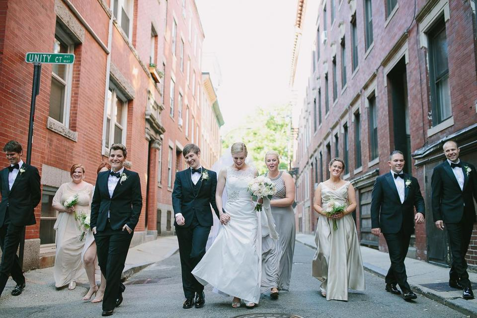 Tiffany (left center) and Samantha Elliott of Groton married at the Old North Church and roamed the North End with their attendants.