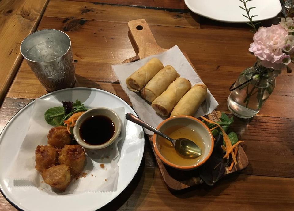 28nodine -- Crying Thaiger features appetizers such as spring rolls and dumplings. Water is served in traditional metal cups imported from Thailand. (Stephanie Schorow)​
