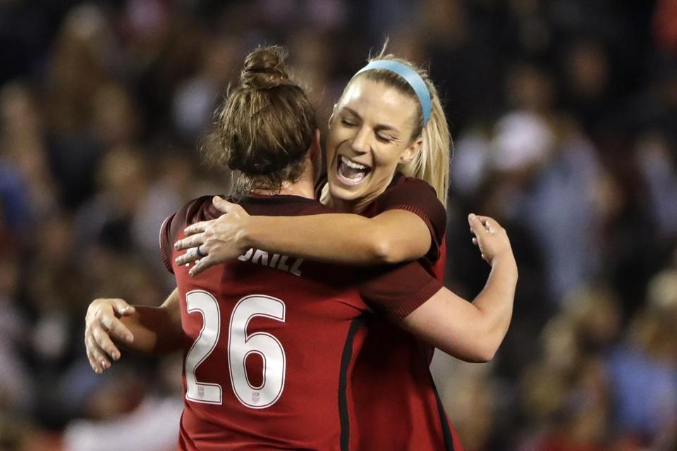 United States midfielder Julie Ertz, right, hugs teammate Savannah McCaskill after defeating Denmark in an international friendly soccer match Sunday, Jan. 21, 2018, in San Diego. (AP Photo/Gregory Bull)