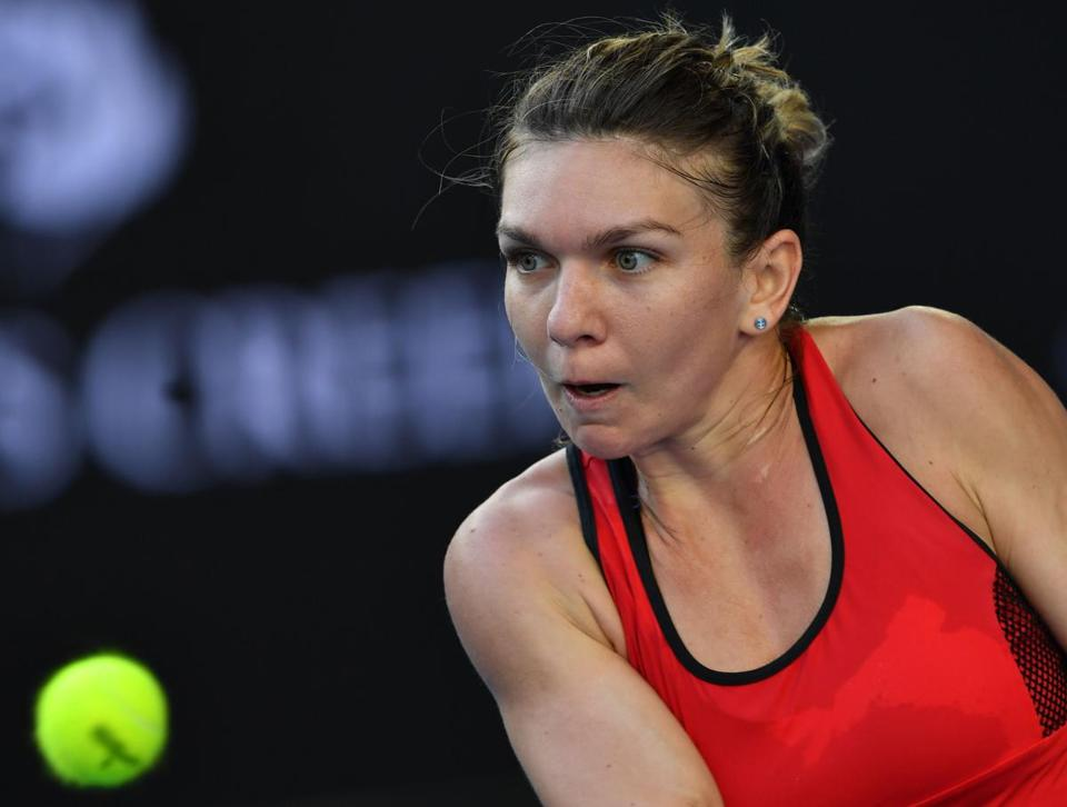 Simona Halep plays a backhand return to Naomi Osaka during their fourth-round match.