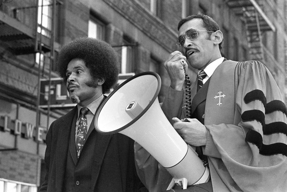 Rev. Walker (right) preached against drug dealers atop a car in an area of Harlem notorious for such activity.