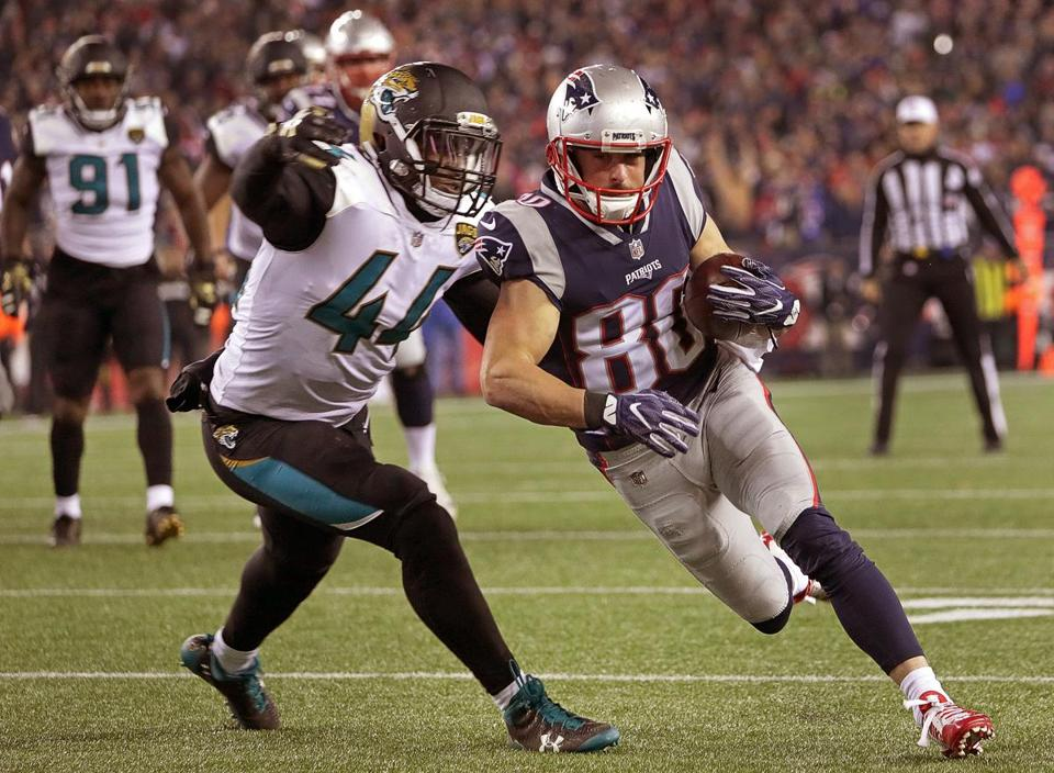 Foxborough, MA 1/21/2018 New England Patriots wide receiver Danny Amendola (80) turns the corner on Jacksonville Jaguars outside linebacker Myles Jack (44) to score the first of his two touchdowns in the fourth quarter for a 17-20 score. The New England Patriots host the Jacksonville Jaguars in an NFL AFC championship game at Gillette Stadium in Foxborough, Mass., Jan. 21, 2018.(Barry Chin/Globe Staff)