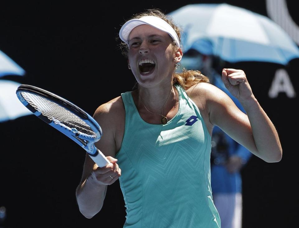 Belgium's Elise Mertens celebrates after defeating Ukraine's Elina Svitolina in their quarterfinal at the Australian Open tennis championships in Melbourne, Australia, Tuesday, Jan. 23, 2018. (AP Photo/Dita Alangkara)