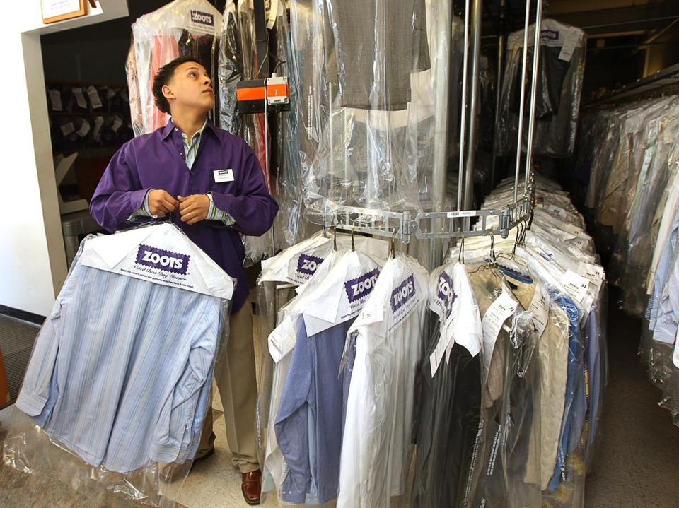 Wellesley, MA - 5/14/08 - Zoots employee Miguel Montalvo (cq) retrieves a customers dry cleaning at Zoots on Washington St. (Mark Wilson/Globe Staff; section: Business; Slug: 15zoots; reporter: Abelson) Library Tag 05152008 National/Foreign