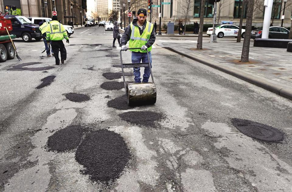 Samuel Brack used a roller to finish off repairs on St. James Avenue earlier in the winter.