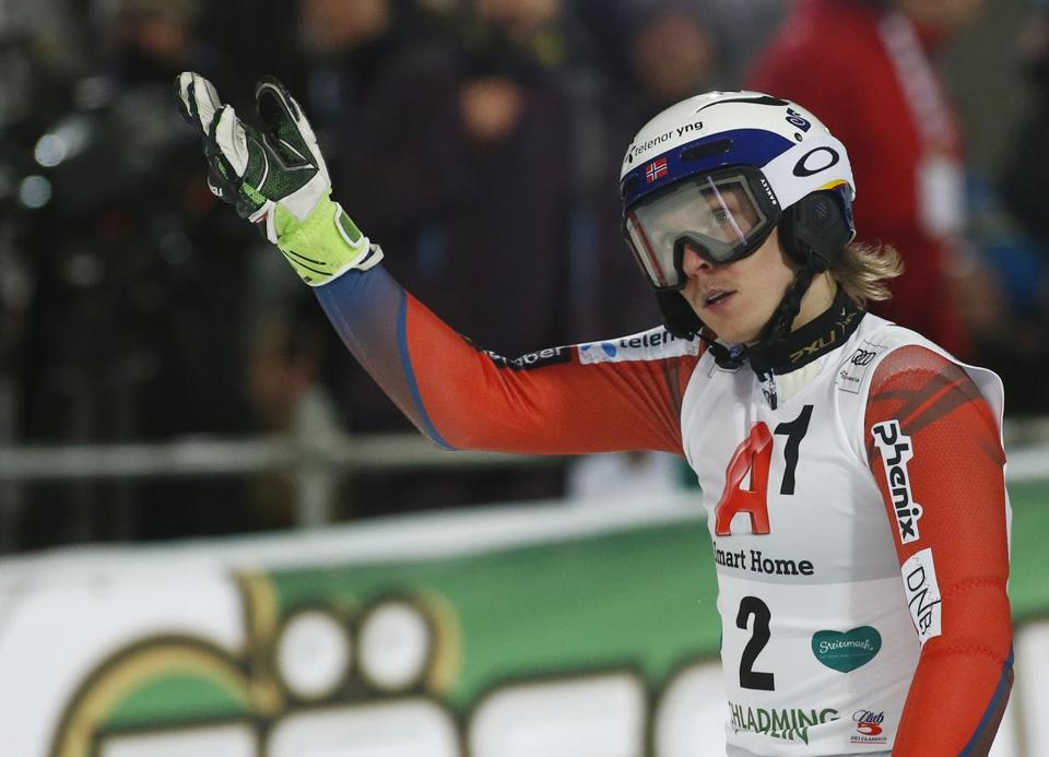 Norway's Henrik Kristoffersen reacts at finish line after somebody in the attendance threw him a snowball during his second run of an alpine ski, men's World Cup slalom in Schladming, Austria, Tuesday, Jan. 23, 2018. (AP Photo/Giovanni Auletta)