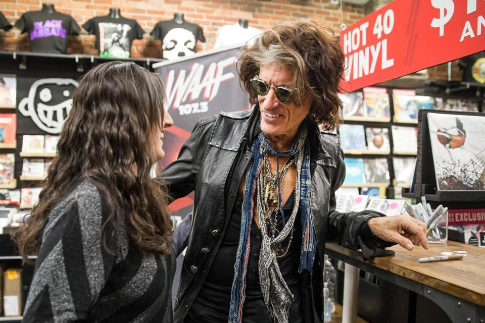 Joe Perry signed an autograph for Kelsey Sullivan at Newbury Comics in Boston on Thursday.