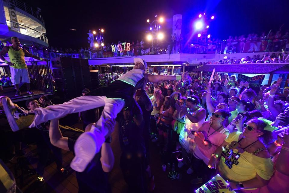 The tireless Donnie Wahlberg crowd surfs. Facing page: