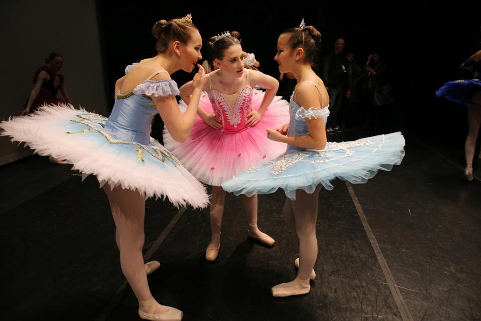 WORCESTER, MA- JANUARY 26, 2018- :(left to right) Isabella Molnar, 13, Olivia Lagano, 13, and Kaya Indyk, 12, of Rockwell Dance Center , Trumbull, CT, check their teeth while preparing for the Junior Classical Competition of the Youth America Grand Prix (YAGP) regional semi-finals at the Hanover Theatre for the Performing Arts in Worcester, MA on January 26, 2018. (Hundreds of ballet dancers - ages 9 to 19 - from all over Massachusetts area will be auditioning this weekend for the Youth America Grand Prix (YAGP) regional semi-finals. Throughout the weekend, the students will attend workshops, competitions, and dance classes. Selected competitors will continue on to the finals in New York City in April. YAGP awards more than $250,000 a year in scholarships to send young dancers to leading schools and dance companies to continue their training. ) (Craig F. Walker / Globe staff) section: metro reporter:
