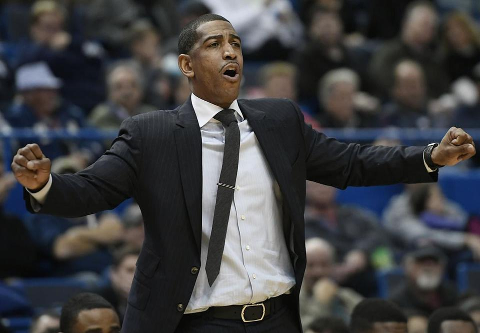 Connecticut head coach Kevin Ollie calls out to his team during the second half of an NCAA college basketball game against Stony Brook, Tuesday, Nov. 14, 2017, in Hartford, Conn. (AP Photo/Jessica Hill)