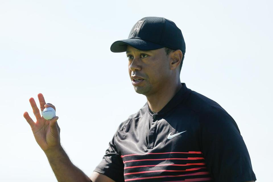 SAN DIEGO, CA - JANUARY 25: Tiger Woods acknowledges the crowd after a putt on the fourth green during the first round of the Farmers Insurance Open at Torrey Pines South on January 25, 2018 in San Diego, California. (Photo by Michael Reaves/Getty Images)