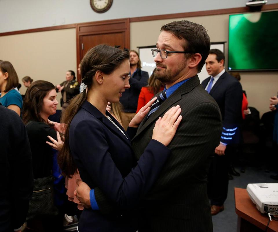 Denhollander was embraced by husband Jacob last week at Larry Nassar's sentencing hearing.