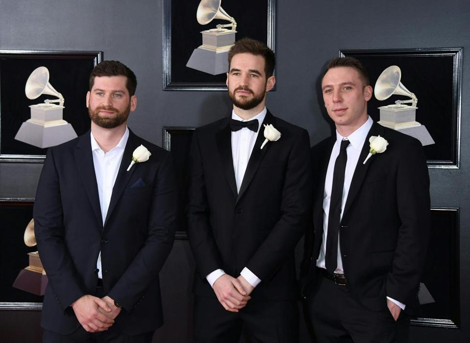 Clayeon Knight (R), Harrison Mills (L), and Wynne from Odesza arrive for the 60th Grammy Awards on January 28, 2018, in New York. / AFP PHOTO / ANGELA WEISSANGELA WEISS/AFP/Getty Images