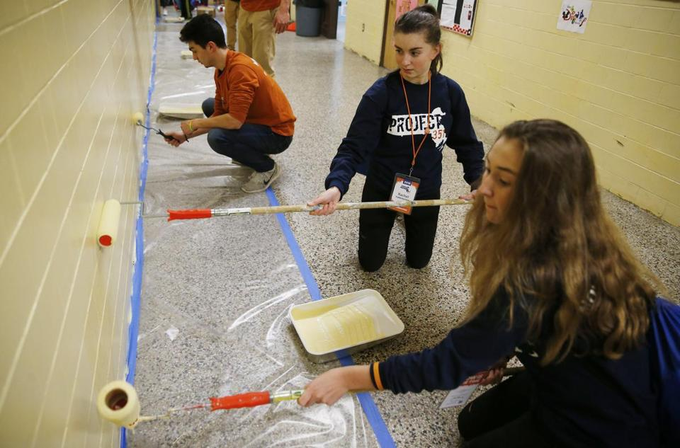 Jill Sferrazza of Lakeville (left) and Rachel Turkington of Sudbury painted the walls inside the Dr. Martin Luther King Jr. K-8 School in Dorchester.