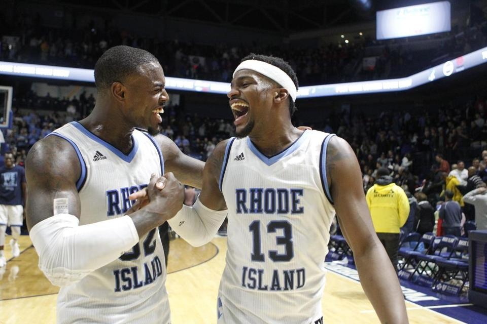 Rhode Island's Jared Terrell (32) and Stanford Robinson (13) celebrate after an NCAA college basketball game against Duquesne, Saturday, Jan 27, 2018, in Kingston, R.I. Robinson hits 3-point shot at the buzzer, sending No. 24 Rhode Island past Duquesne 61-58. (AP Photo/Stew Milne)