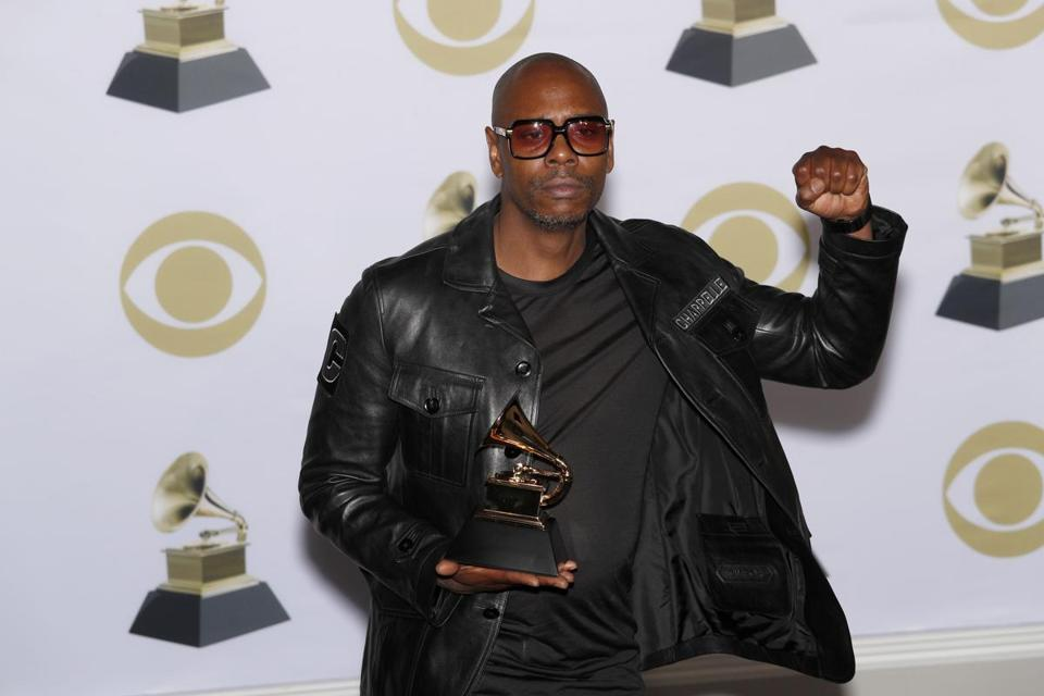 Dave Chappelle posed with his Grammy Award.