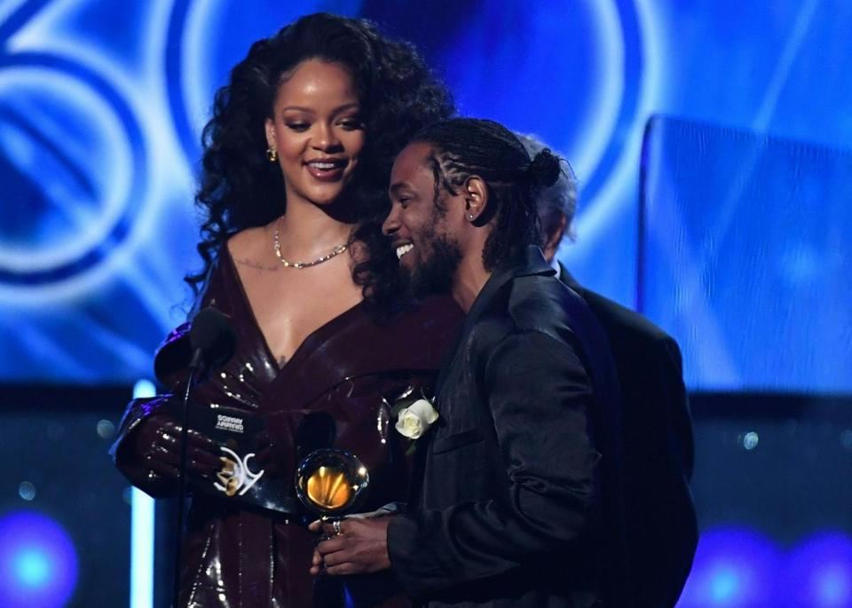 Rihanna (L) and Kendrick Lamar receive the Grammy for Best Rap performance during the 60th Annual Grammy Awards show on January 28, 2018, in New York. / AFP PHOTO / Timothy A. CLARYTIMOTHY A. CLARY/AFP/Getty Images