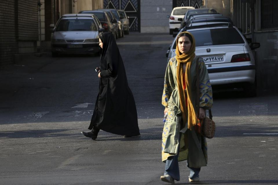 Two Iranian women made their way across a square in downtown Tehran.