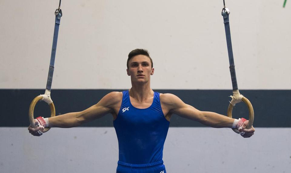 Braintree, MA - 1/30/2018 Braintree High school Jake Barrett competes in rings at gymnastics meet at Braintree High School. - (John Cetrino for The Boston Globe) SPORTS Andrew Higginbottom