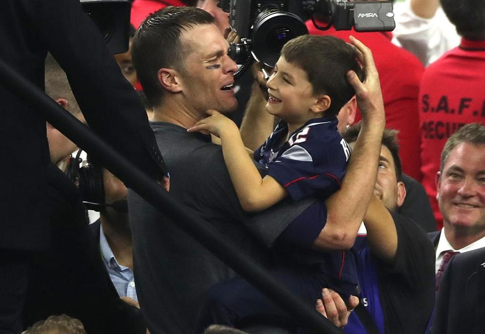 Tom Brady with his son after the Patriots won Super Bowl LI.