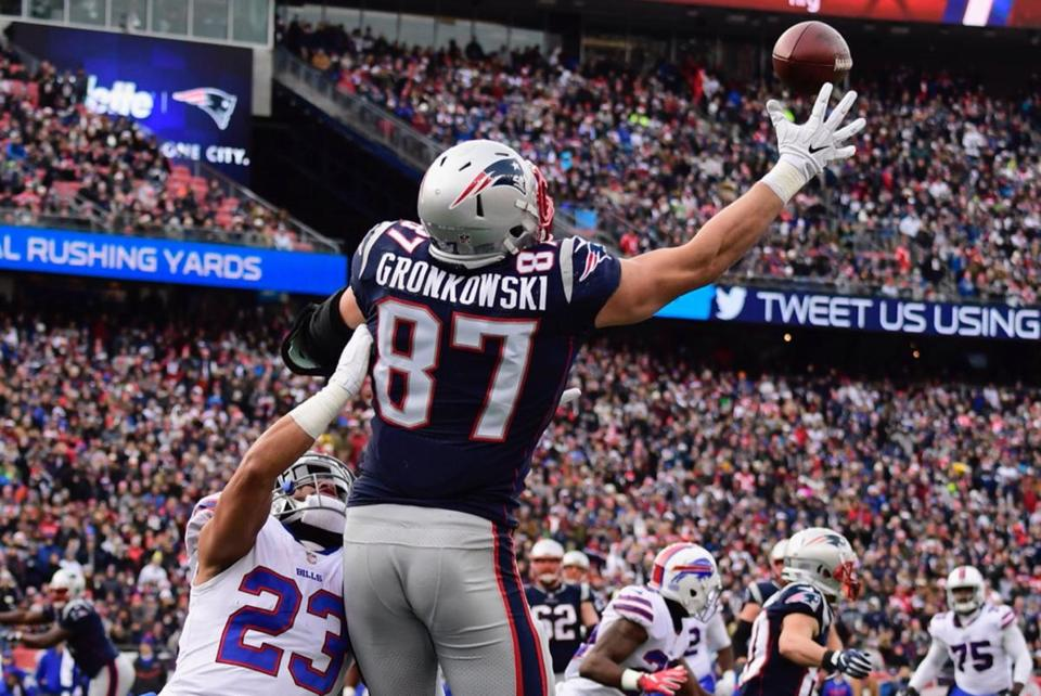 Mandatory Credit: Photo by JOHN CETRINO/EPA-EFE/REX/Shutterstock (9301147n) New England Patriots tight end Rob Gronkowski (R) makes a touchdown catch as Buffalo Bills strong safety Micah Hyde (L) defends during the first half at Gillette Stadium in Foxboro, Massachusetts, USA 24 December 2017. Buffalo Bills at New England Patriots, Foxboro, USA - 24 Dec 2017