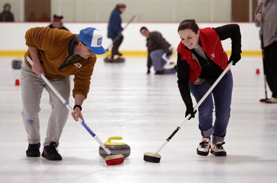 Brian Luper at left and Alli Butler, both from Auburn, tried out curling at Marlborough Curling Club in January.