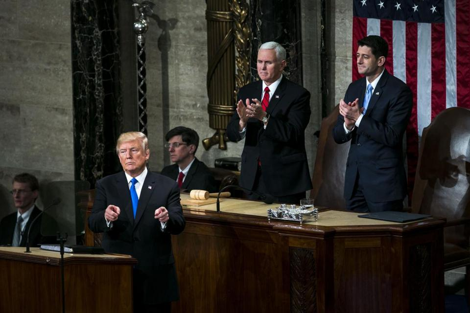 President Donald Trump (left) gestures while delivering a State of the Union address to a joint session of Congress at the U.S. Capitol in Washington on Jan. 30, 2018. MUST CREDIT: Bloomberg photo by Al Drago.