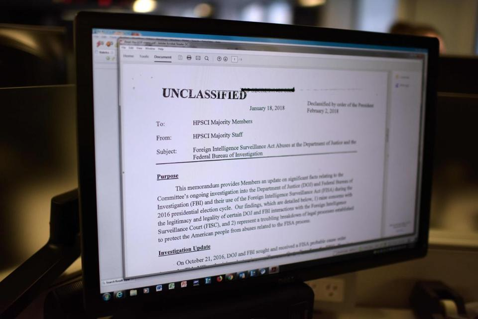 "The Republican memo released by Congress is displayed on a journalist's computer screen at a newsroom in Washington DC, on February 2, 2018. The US Congress released a Republican memo alleging that the FBI abused its power to spy on President Donald Trump's election campaign. Based on classified materials, the four-page memo claims that the FBI used an unsubstantiated, Democratic-funded research report to obtain a warrant to surveil Trump advisor Carter Page, who had extensive russian contacts. ""I think it's terrible. I think it's a disgrace what's going on in this country,"" Trump said of the memo's contents. / AFP PHOTO /"