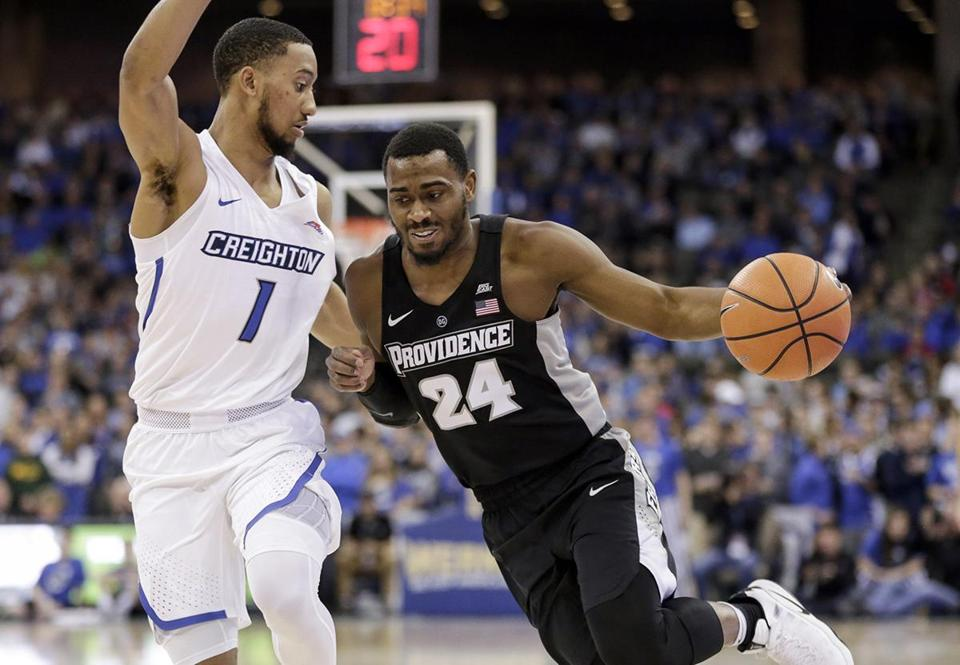 Providence's Kyron Cartwright (24) tries to drive around Creighton's Davion Mintz (1) during the first half of an NCAA college basketball game in Omaha, Neb., Sunday, Dec. 31, 2017. (AP Photo/Nati Harnik)