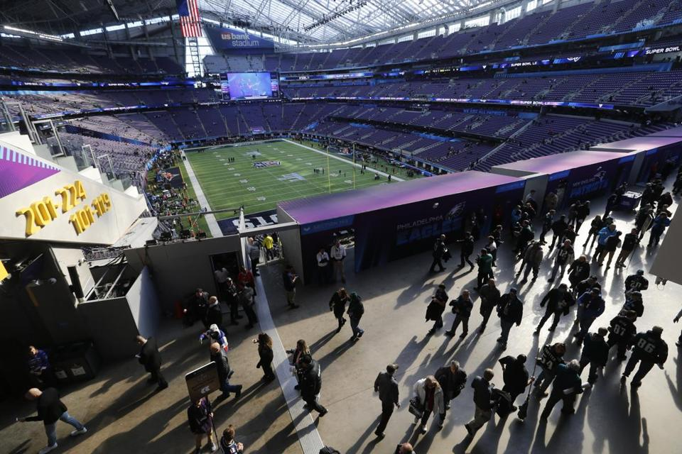Fans stream into the stadium houts before Super Bowl LII.