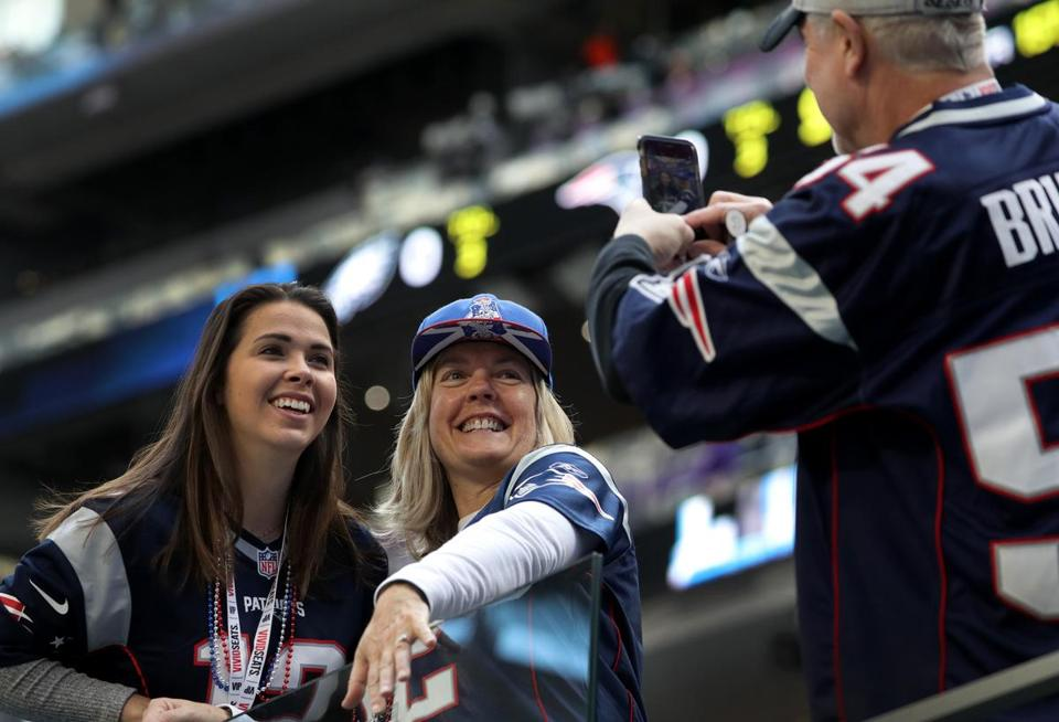 A pair of Patriots fans get their picture taken inside the stadium.