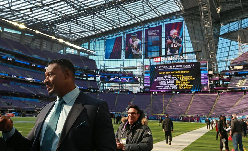 Willie McGinest, the NFL Network analyst who was part of the victorious New England team that beat the Eagles in Super Bowl XXXIX, walks along the field about four and a half hours before kickoff.