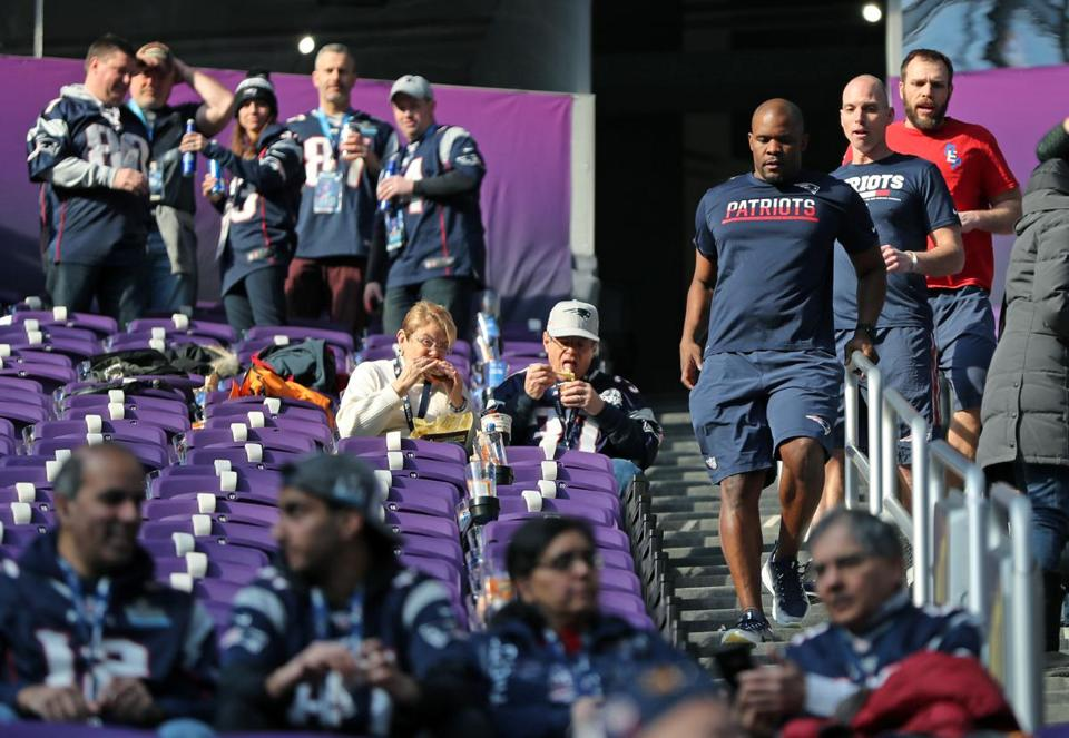 Just as they do before every game, more than three hours before kickoff, Patriots linebackers coach Brian Flores (front), wide receivers coach Chad O'Shea (center) and defensive line coach Brendan Daly (rear) were in the stands running the stairs among the fans.